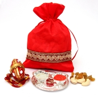 Dry fruits potli and silver plated Roli Chawal container